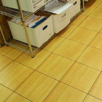 Modular raised floor tile basement floors and court for Modular basement flooring